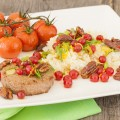 Caramelised pecan nuts with rice and oven baked tomatoes