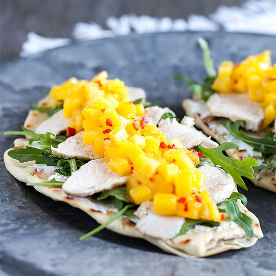 Mango and chicken with goat cheese on naan bread