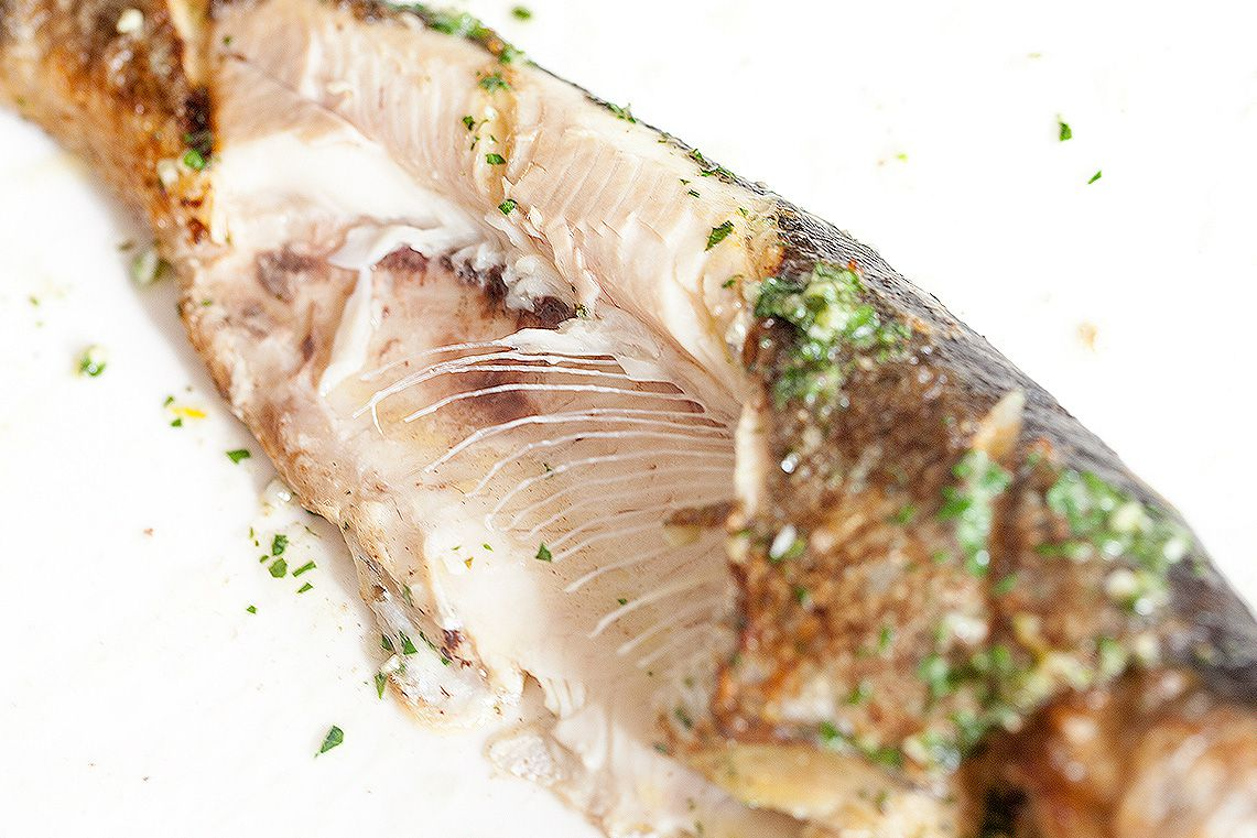 Trout with herb butter well cooked
