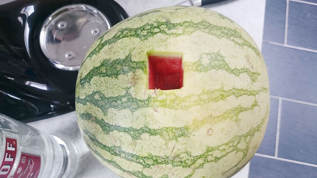 Drunken watermelon liquor with the square cut out