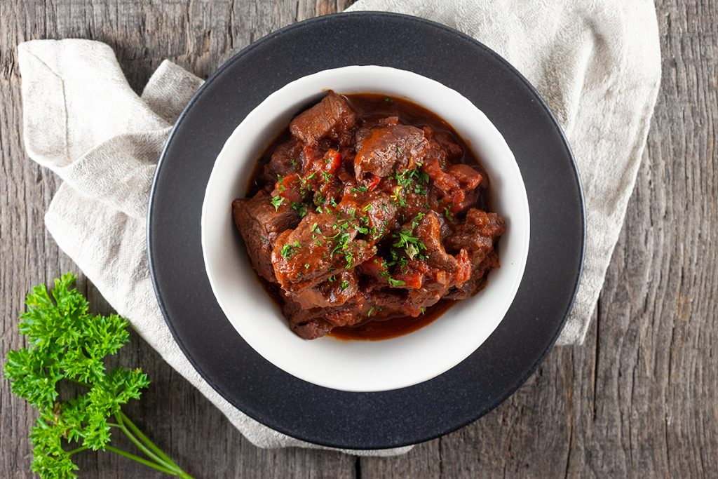Beef sirloin in red wine sauce casserole