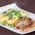 Pork belly slices and broad bean potato salad