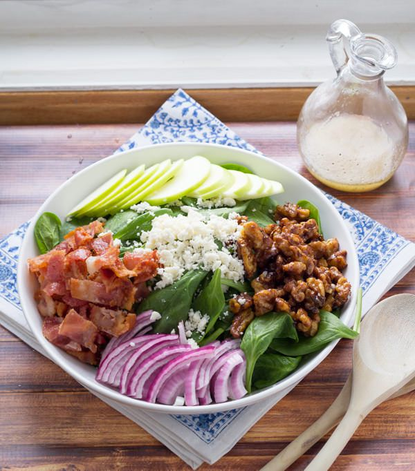 Spinach salad with apples, bacon and spicy maple walnuts