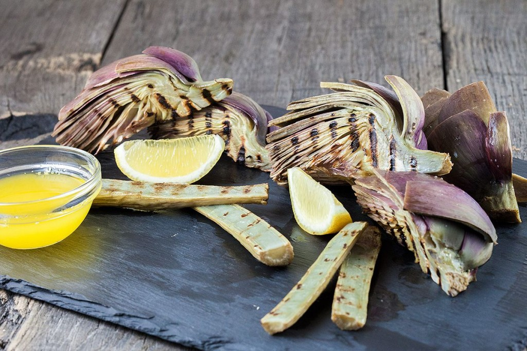 Grilled artichokes and stems with lemon butter sauce