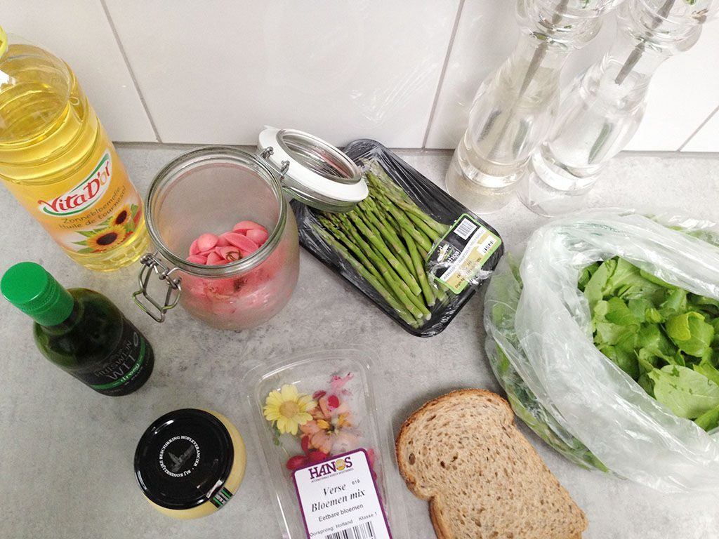 Green asparagus salad with edible flowers ingredients