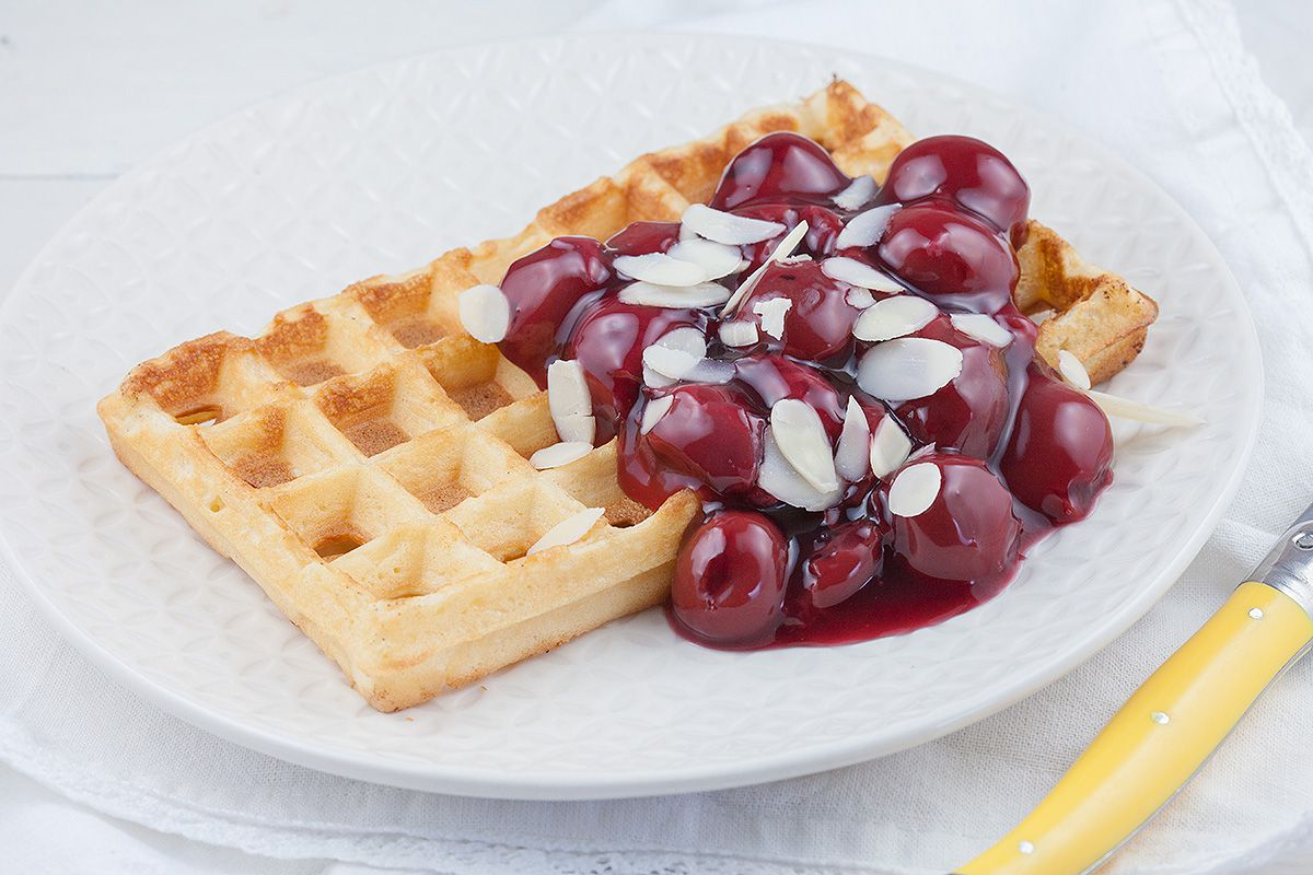 Waffles and warm cherries