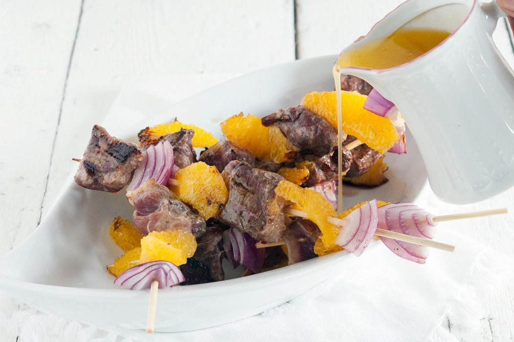Duck kebabs with orange butter sauce