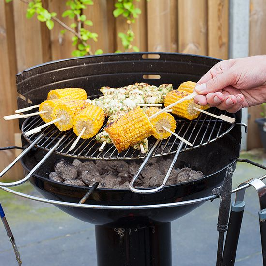 Barbecued corn on the cob with garlic butter