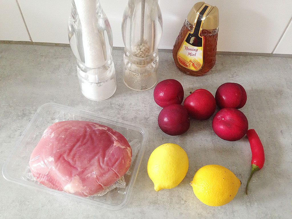 Slow-cooked ham with plums and lemon ingredients