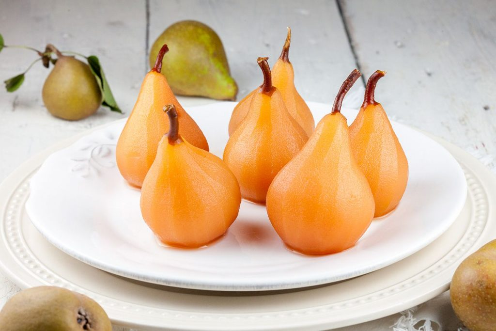 Poached pears in apple juice