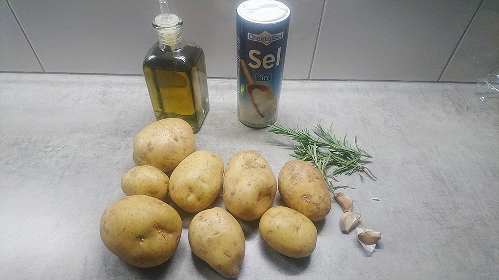 Oven baked potato wedges with rosemary and garlic ingredients