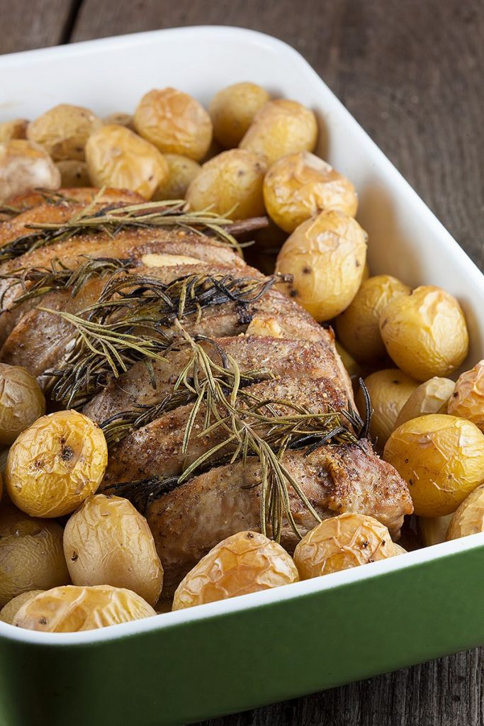 Oven-roasted pork loin with rosemary and potatoes