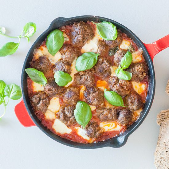 Oven baked meatballs in tomato sauce and mozzarella