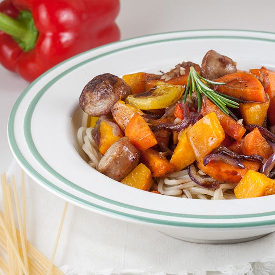 Pasta with oven-baked vegetables and sausage