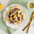 Spicy red rice salad with chicken and mango