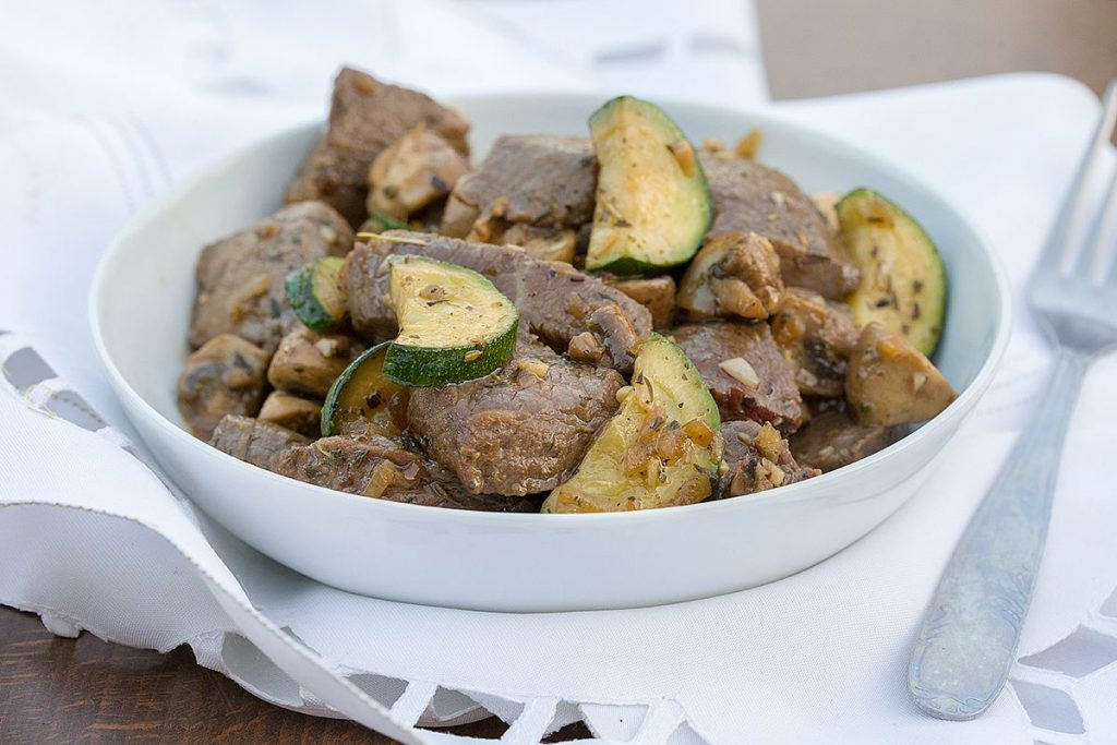 Marinated beef with zucchini and mushrooms