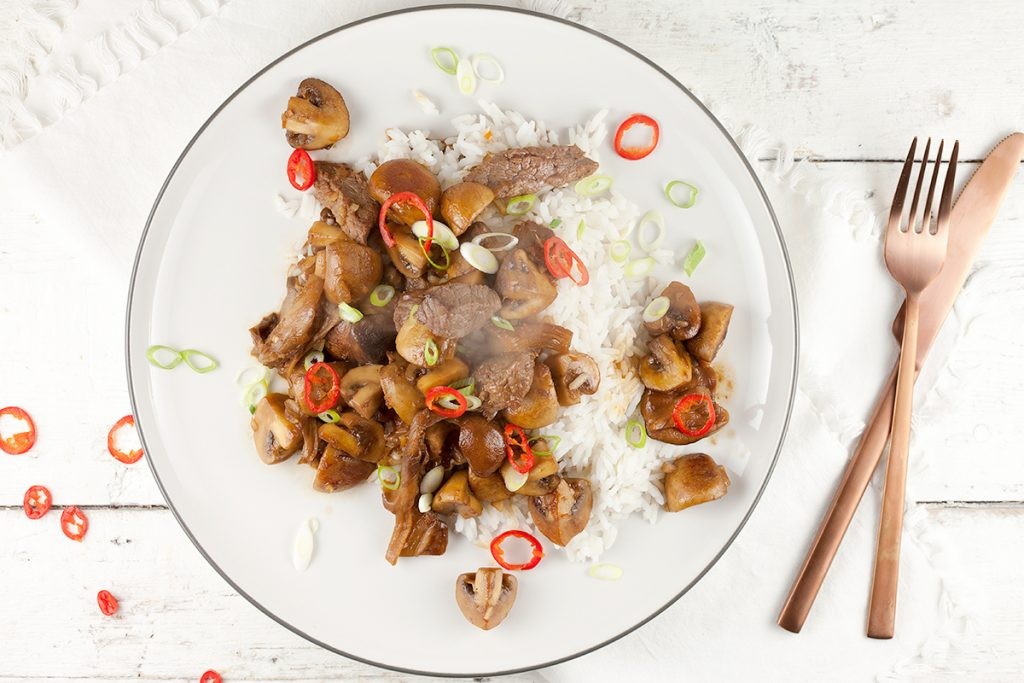 Rice with mushrooms, beef and soy sauce