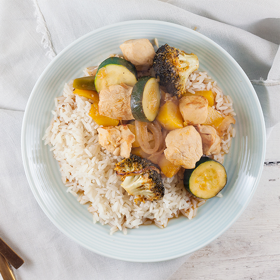 Sweet and sour chicken, vegetables and peaches