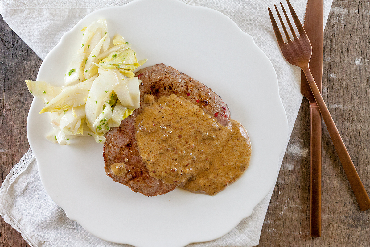 Steak with pink peppercorn sauce