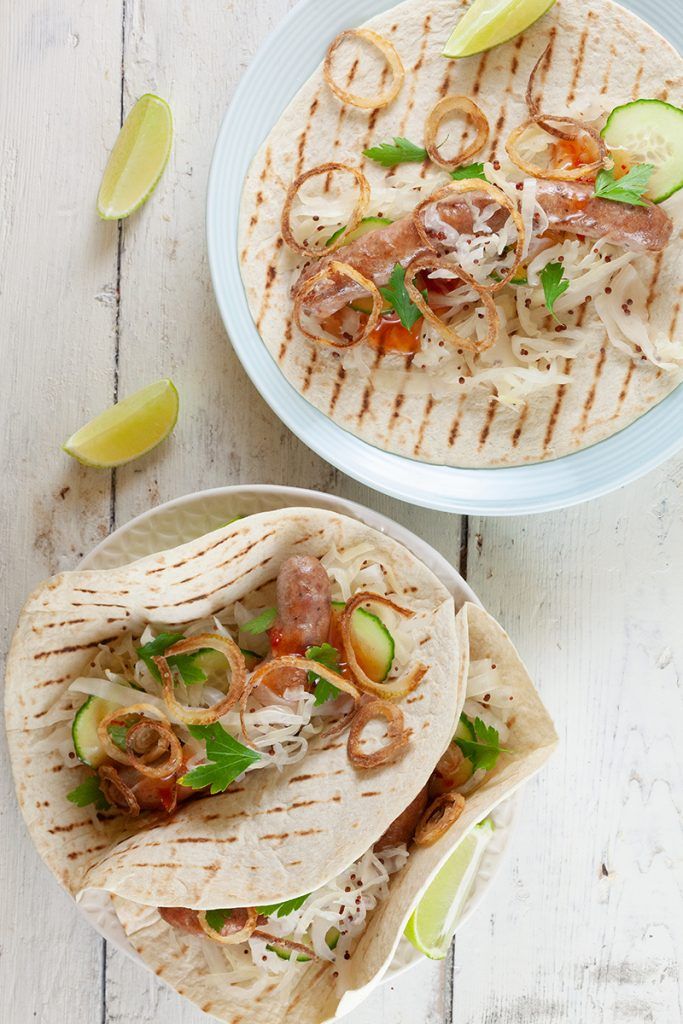 Tortillas with sausages, white cabbage and crispy onions