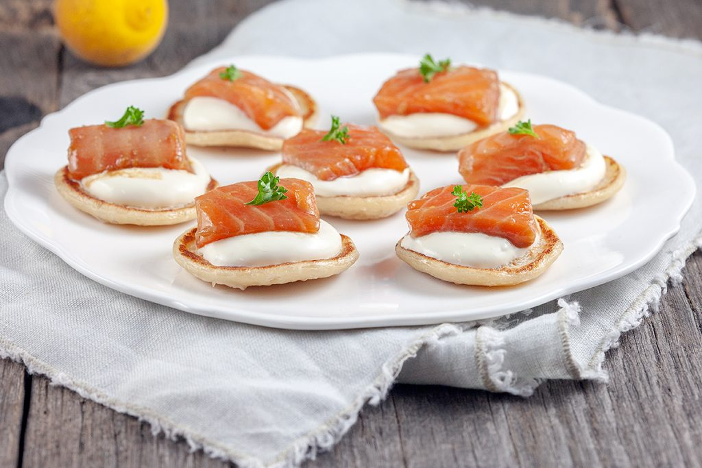 Salmon and yuzu blinis