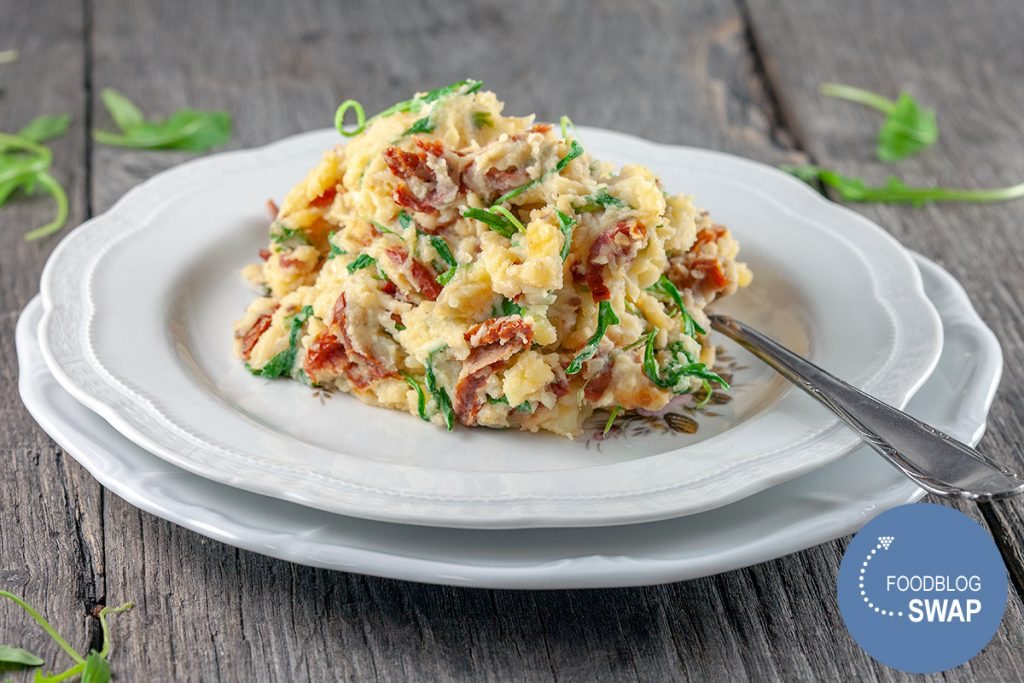 Arugula and sun-dried tomato mash