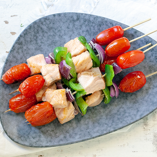 Barbecued salmon kebabs square - Barbecued salmon kebabs