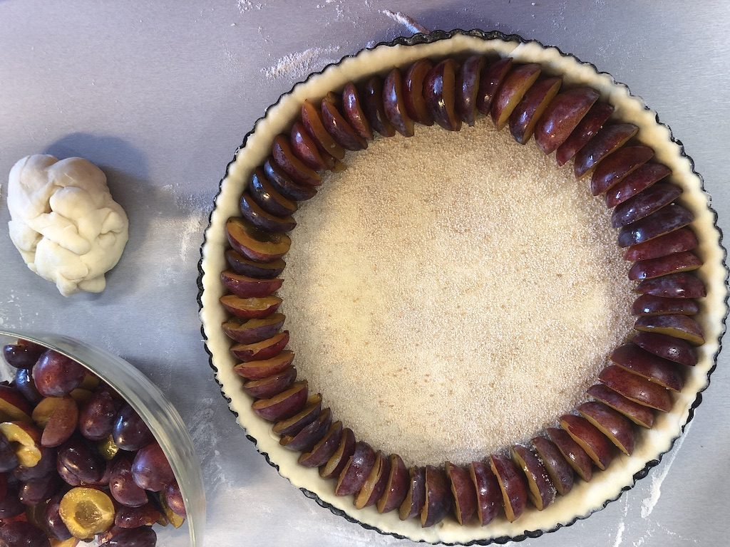 Making the Dutch plum pie
